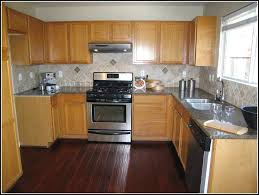 kitchen with light wood cabinets in light wood cabinets with dark wood floors 56 about remodel