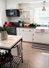 painting knotty pine kitchen cabinets white remodelaholic kitchen renovation updating knotty pine