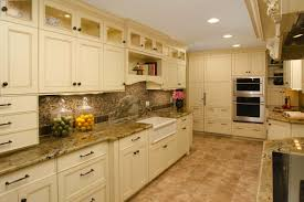 walnut wood dark roast amesbury door cream colored kitchen