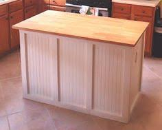 unfinished kitchen islands diy butcher block cabinet bottom island with electric outlet