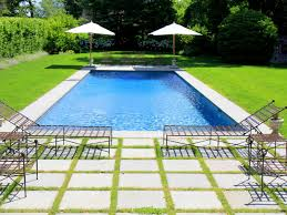 flooring elegant backyard pool with large concrete pavers and