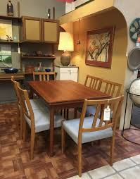 remnant this danish teak draw leaf dining table is a nice match for our set of 6 teak dining chairs