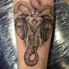 grey ink elephant head tattoo on arm