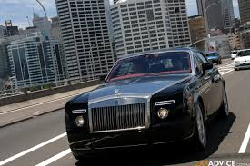 rolls roll royce full throttle in a rolls royce phantom coupe