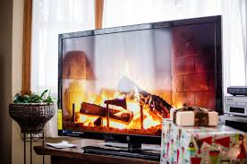 television over fireplace why you shouldn t hang your tv over your fireplace