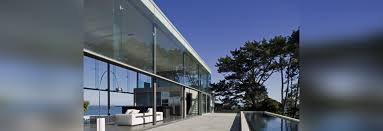 a double height glass box overlooking the ocean by fearon hay