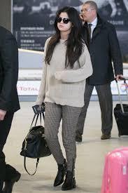 selena gomez sweater slacks and a sweater selena gomez airport style popsugar