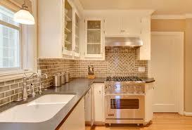 backsplash tile patterns kitchen traditional with beige cabinets