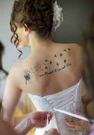 newly married show her nice upper back dandelion tattoo