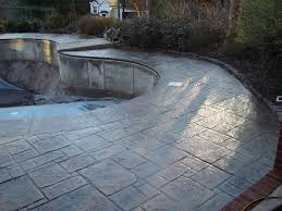 stamped concrete pool deck and staircase with fiber optic light system