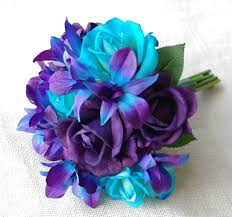 teal roses touch purple and teal turquoise roses with mokara orchids