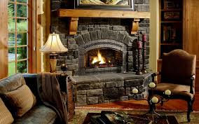 antient style corner fireplace stone facing with sconces and candles