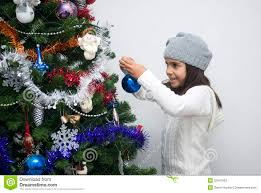 putting ornament on tree stock photo image 22541952