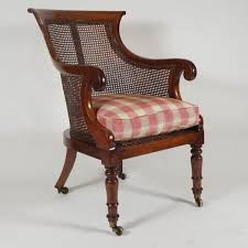 english regency period caned mahogany armchair or bergere circa