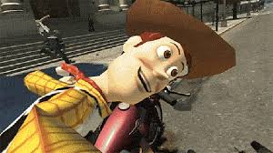 the real version of story s woody hanging on a back of a car