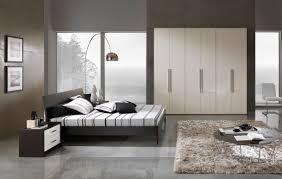 grey ceramic flooring tiles with arc floor lamp above bedstead