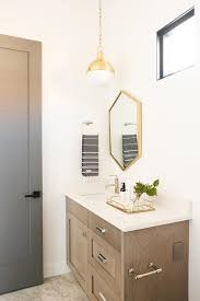 gold hexagon mirror with gray wash wood bath vanity transitional