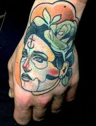 woman u0027s face tattoo on hand www skindeepinktattoo com