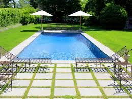 backyard with pool and grass tropical home with backyard pool
