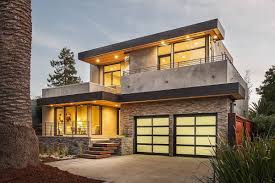 garage modern garage door design with concrete driveway at the full size of garage modern house design with stone wall decor including bright lighting ceiling plus