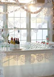 Winter Party Decorations - winter wonderland bar snowflakes windows martini glasses chocolate
