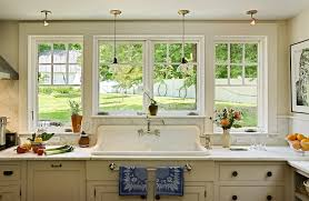 double pendant lights over sink traditional kitchen burlington bare windows kitchen traditional with yellow cabinets