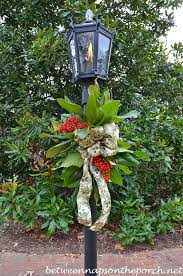 Lantern Decorating Ideas For Christmas Decorate A Lantern For Christmas With Greenery From The Garden