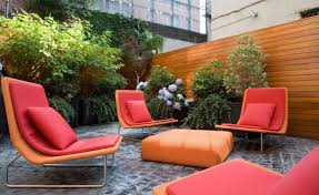 modern outdoor furniture displayed by red and orange