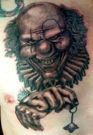 creepy smiling clown portrait chest tattoos photos