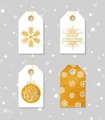 collection of four gold texture christmas and new year gift tags
