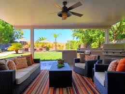 neutral contemporary outdoor living room design with black rattan