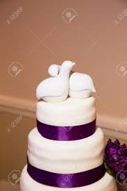 this ceramic cake topper has two love birds on it in all white