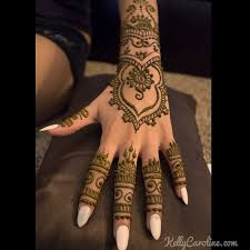 edding henna on the top of a hand for a lovely bride henna