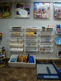 use pegboard under the top cabinets this would work in the laundry
