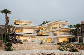 level house a multi level house sits on the shores of the mediterranean