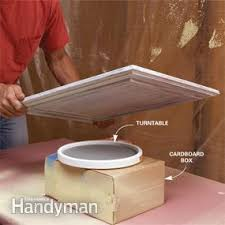 How To Finish The Top Of Kitchen Cabinets How To Spray Paint Kitchen Cabinets Family Handyman