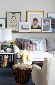 a massive wood picture ledge for the living room chris loves julia we had a couple photo ledges in our last house and we loved missed the casual leaned art look and the ease of switching things around