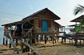 thai wooden house on stilts on the beach of ko mook island