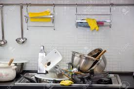 Kitchen Photography by Heap Of Dirty Utensil On The Kitchen Stock Photo Picture And