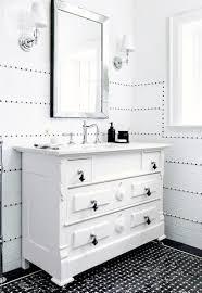white on black bathroom white vanity black basketweave tile floor