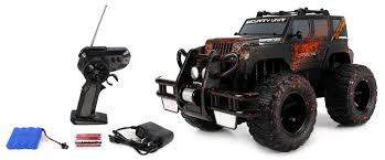 muddy monster truck videos amazon com velocity toys mud monster jeep wrangler electric rc