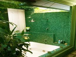 fresh bathroom look with green tiles on walls and floors green
