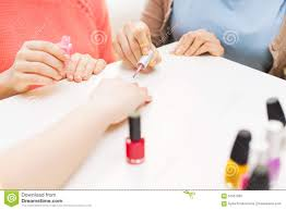 close up of young women with nail polish stock photo image 67651335