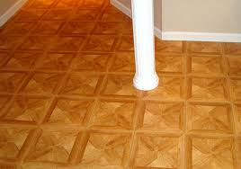 parquet flooring tiles installed in a corner and around a support post in a basement