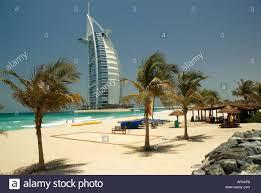 the burj al arab hotel with palm tree lined beach dubai united