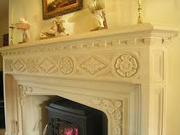 a tudor or gothic fireplace in stone