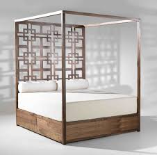 bedroom wooden modern canopy bed with white bedding and storage