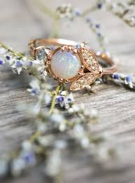 cornflower blue opal antique inspired opal engagement ring with vintage diamonds