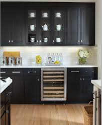 black kitchen cabinets with white subway tile backsplash black kitchen cabinets with marble countertops
