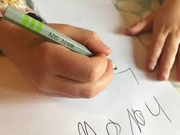 paper with writing on it 10 reasons to encourage children to write letters counting to ten a close up picture of m s hands writing on white paper with a pencil which is